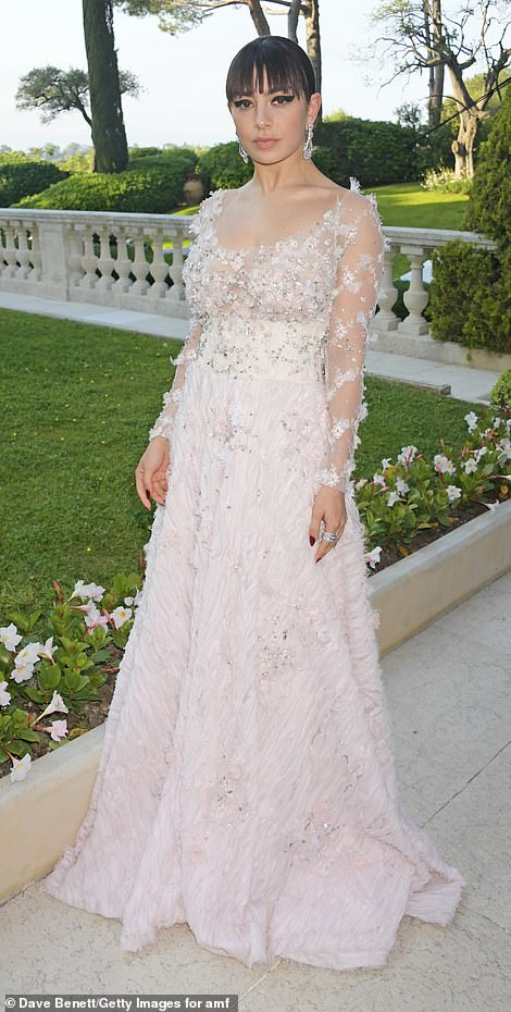 Stunning: Known for her sensational style risks, Charli XCX opted for a stunning baby pink gown which drew focus to her trim midriff