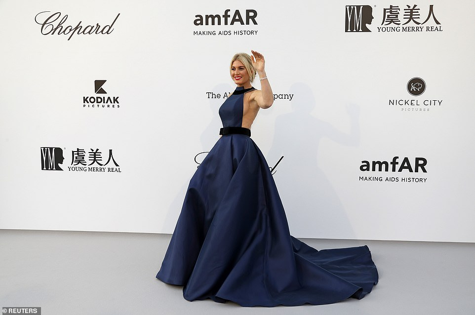 Beauty: Hofit Golan commanded attention in an opulent navy dress as she waved to photographers
