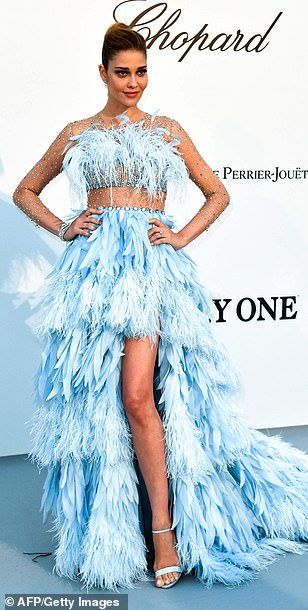 Blue-tiful! Brazilian model Ana Beatriz Barros commanded attention in a faux fur baby blue gown which showed off her toned stomach