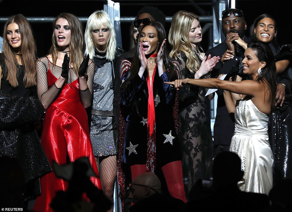 Big show! Later after the runway event, Winnie joined the sew of models in giving a round of applause, as Eva Longoria also took to the stage