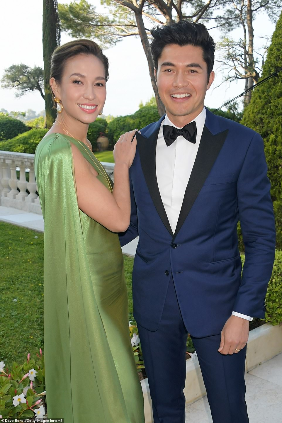 Twosome: Liv Lo Golding and Henry Golding cosied up for a sweet snap in the courtyard