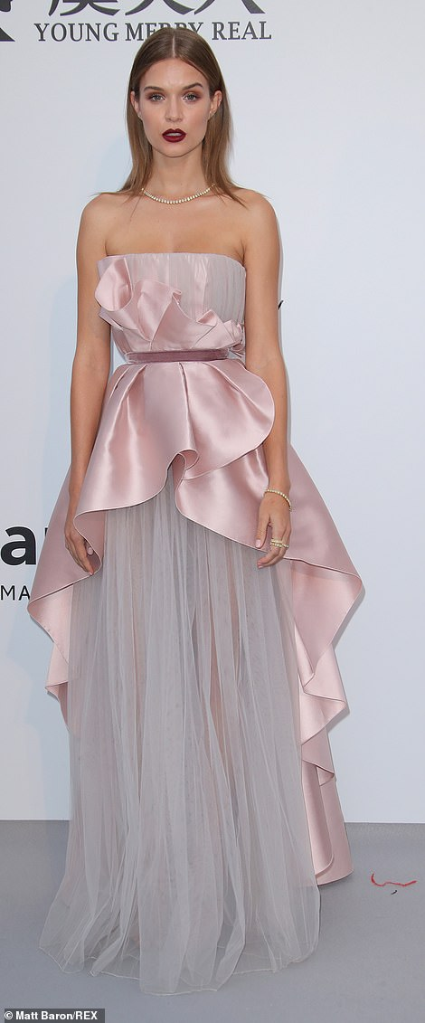 Va va voom! Josephine Skriver also turned heads in a gorgeous strapless pink gown which cinched in her waist and fell in statement tiers