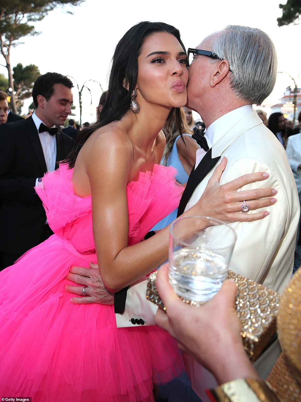 Fashion friends: Kendall kissed fashion designer Tommy Hilfiger at the glittering gala