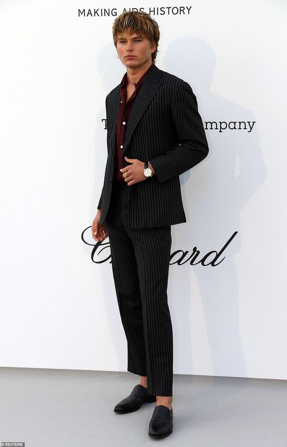 Hunk: Jordan Barrett looked fantastic in a pinstripe black suit and burgundy top