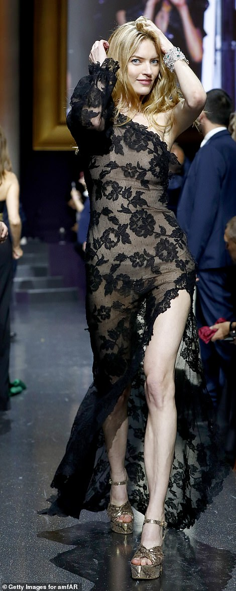 Revealing:Martha Hunt, 30, put her perfect features on display in a sheer black lace gown