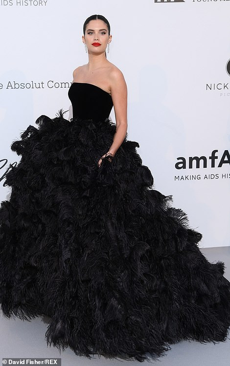 Eyes on her: Sara Sampaio oozed glamorous in an extravagant black Armani Privé ballgown which was strapless and fell in eye-catching ruffles