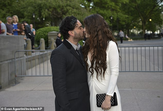 Sweet smooch: The happy couple couldn't keep their lips off one another