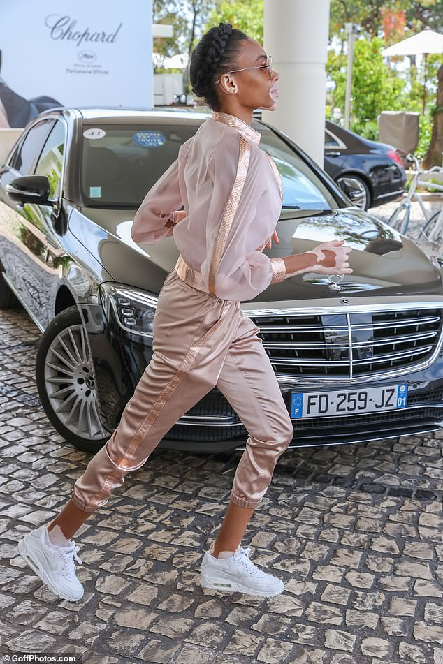 In a hurry? The Brit beauty looked in a hurry as she dashed inside the luxe hotel in Cannes