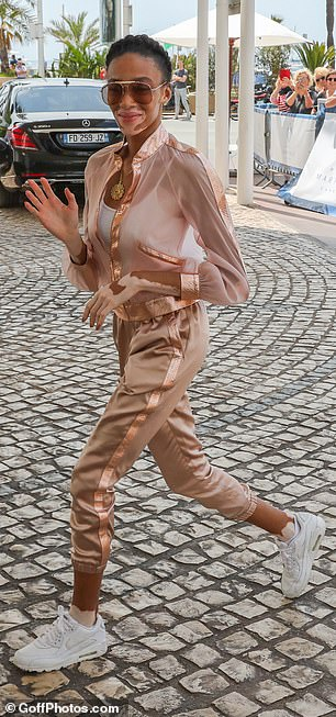 Fashion forward: The model, 24, looked gorgeous in a metallic tracksuit as she greeted fans outside before dashing inside