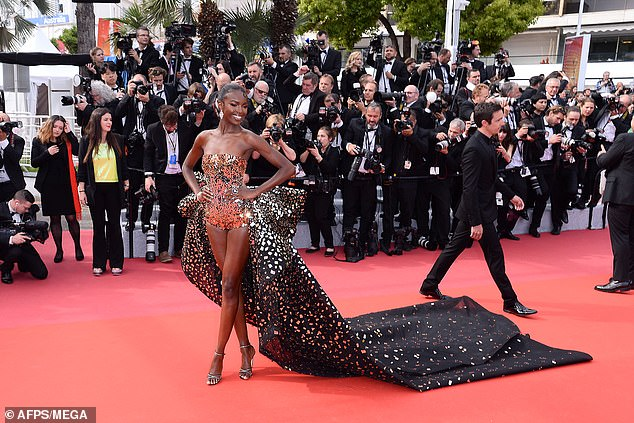 All eyes on her: The 26-year-old seemed to be preparing for her new role as a Victoria's Secret  Angel as she strutted down the red carpet in a jaw-dropping metallic gown