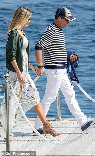 Smitten: The pair strolled along hand-in-hand as they enjoyed the sunshine