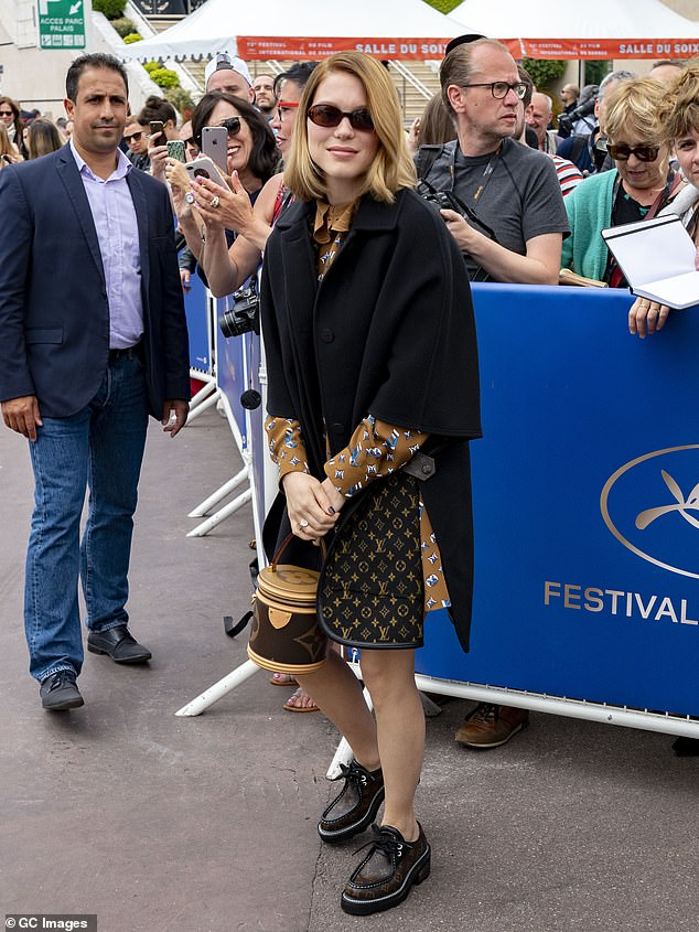 Sense of style: Bond actress Lea Seydoux showed off her designer accessorised as she greeted fans during an appearance in Cannes