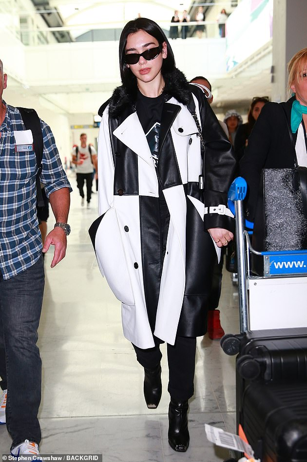 Tired: Dua looked weary as she strutted through airport