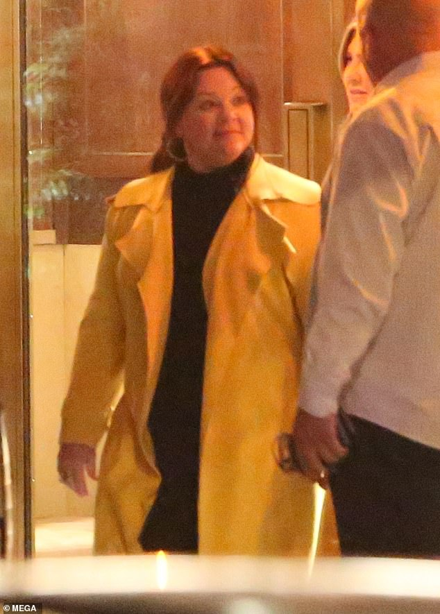 Sunny days: Melissa was a ray of sunshine in the night as she sported a bright yellow coat over a black dress
