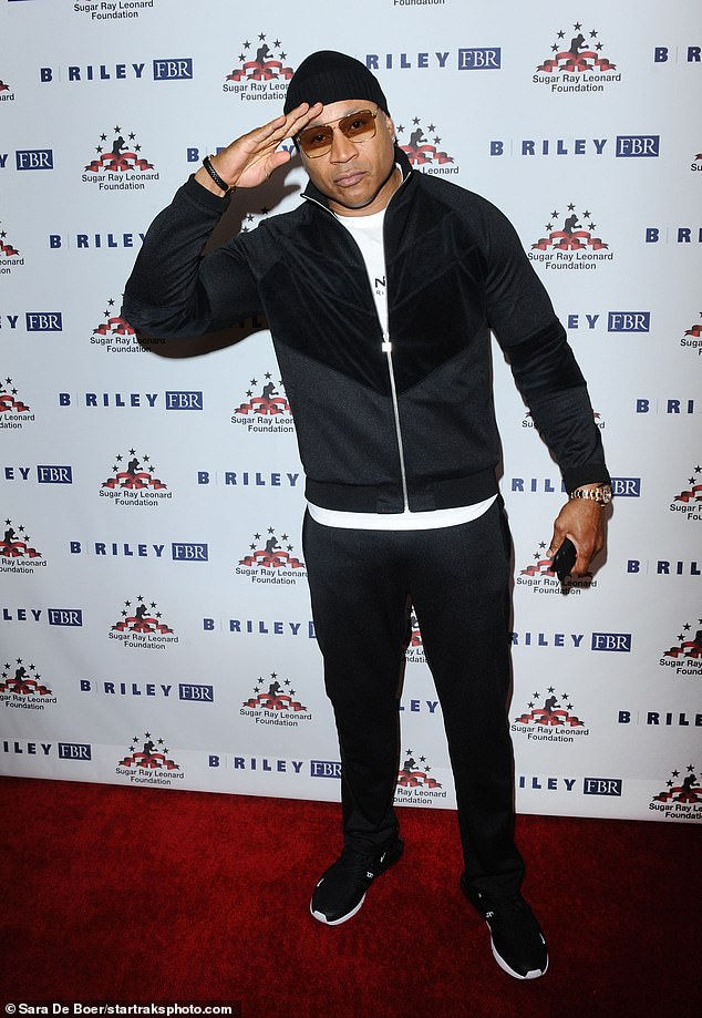 Ladies Love Cool James:Other celebs in attendance was LL Cool J, who gave a salute while posing with a white shirt under a black zip-up top and black pants and shoes