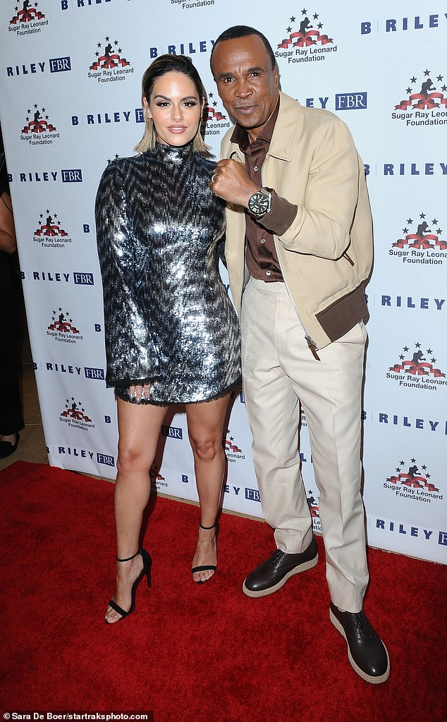 Pia and Ray:Former American Idol contestant Pia Toscano posed with Leonard in shimmer silver mini-dress