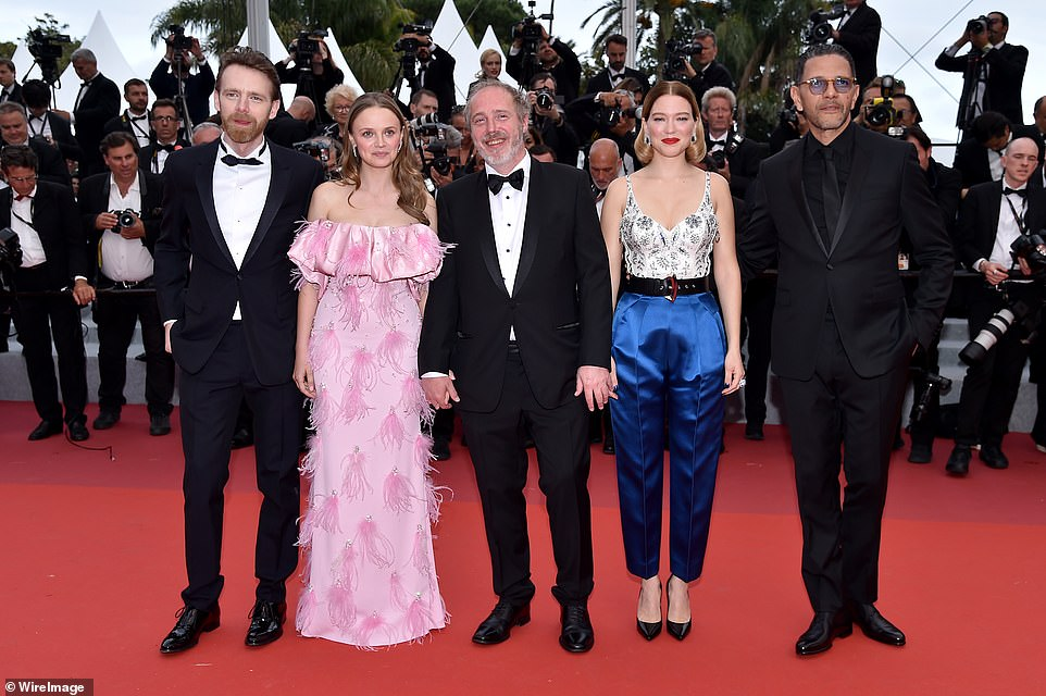 Cast: (L-R) The cast of Oh Mercy! Antoine Reinartz, Sara, Arnaud Desplechin, Lea and Roschdy Zem held hands at the event