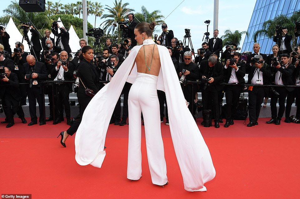 Striking: Stepping up the style stakes, Josephine displayed her flair for fashion in a sizzling backless white jumpsuit, including a pair of wide-leg trousers and an incredibly turtle-neck cape