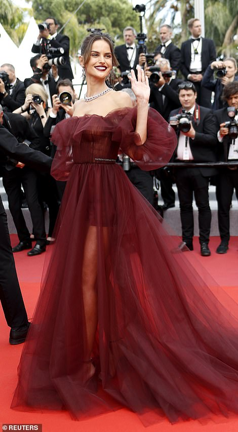 Ooh-la-la: Nailing vampy chic, Izabel caught the eye with her off-the-shoulder burgundy tulle gown, which came complete with ruffled sleeves for added drama