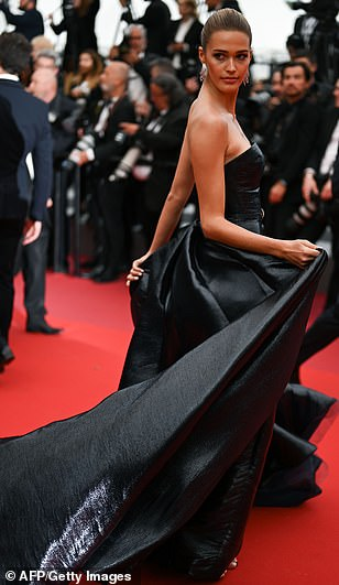 Leather fantasy: IMG model Noel Berry showed off her athletic figure in a black strapless maxi dress with a ruffled maxi skirt