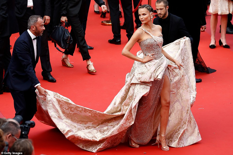 It's all about her: Russian supermodel Natasha Poly, 33, twirled along the red carpet in a bedazzled maxi dress, which displayed her lean legs with its thigh-high slit