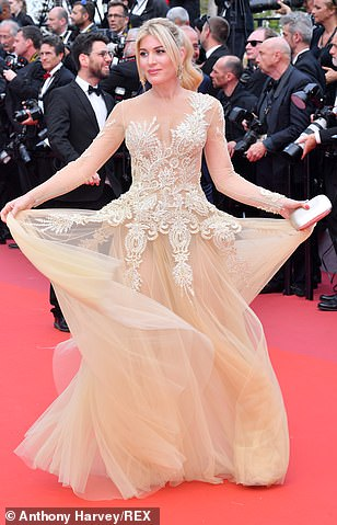Show-stopper: Presenter Hofit Golan opted for full-on glamour in a gold semi-sheer gown, with bedazzled embroidery covering her modesty