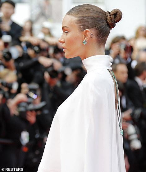 Intricate details: Josephine tied her blonde locks into a sleek bun to reveal her out-of-this-world beauty, which was complemented with winged eyeliner and faint pink lipgloss