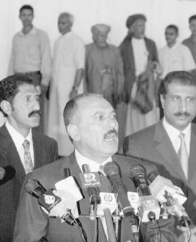 President Ali Abdullah Saleh of Yemen (center) has asked citizens to follow his lead and only chew khat on weekends. Yemen reportedly has the largest population of khat chewers worldwide. AP/Wide World Photos.