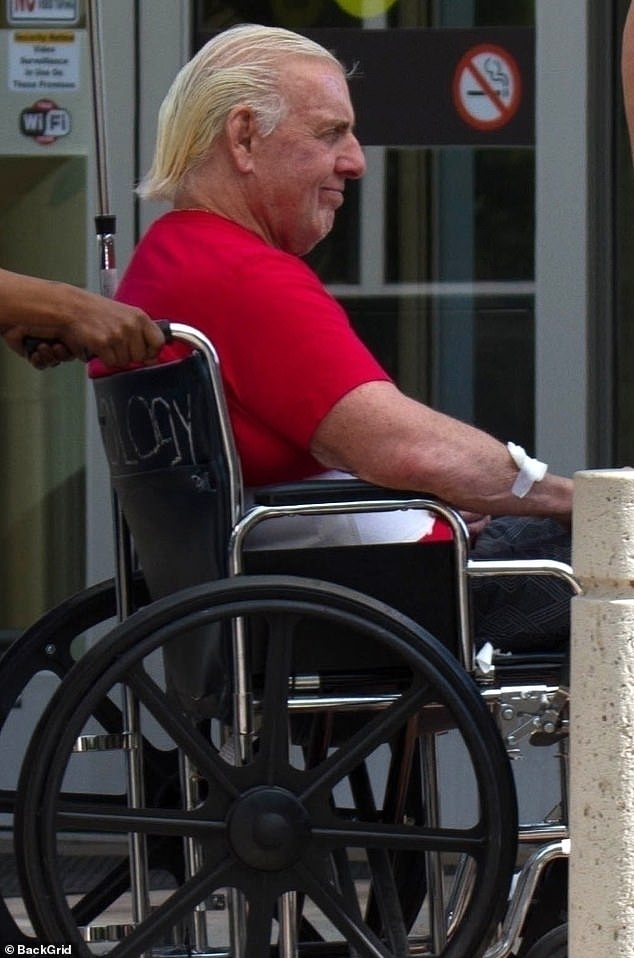 The 70-year-old was pushed along in a wheelchair, but he appeared to be in high spirits as he headed back to his home