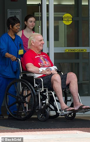 Flair sported a smile as he headed out of the medical facility