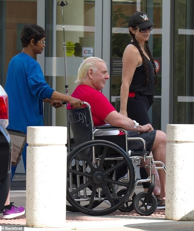 Flair married his fifth wife  Wendy Barlow (right) last year, and she has been by his side during his medical emergency