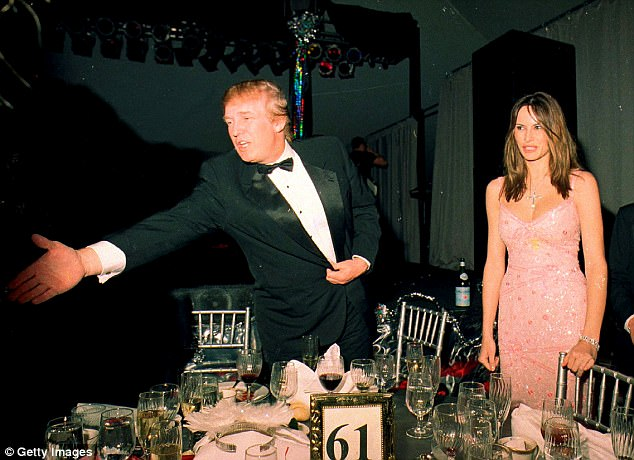 Trump reportedly made the comment to the writer after a 'young socialite' caught his eye at  Mar-a-Lago golf club during dinner. Above in 2000 at Mar-a-Lago with Melania Knauss