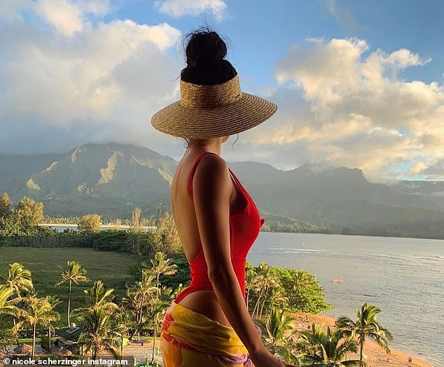Island vibes: 'Home for the weekend,' the Pussycat Dolls frontwoman captioned the photo (pictured in Hawaii on May 21)