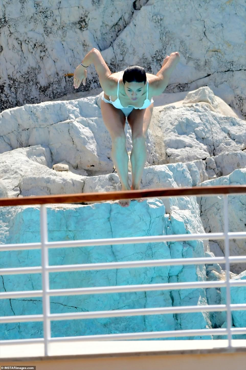 Taking a leap: Michelle showed off her impressive diving skills as she jumped into the water