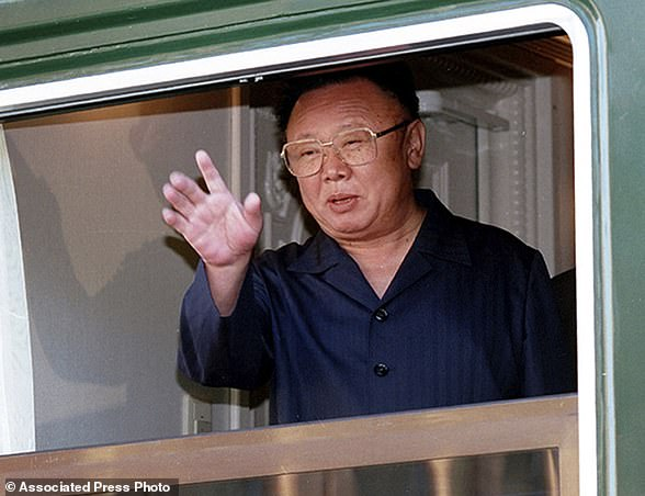 FILE - In this 2002 file photo, then North Korean leader Kim Jong Il waves out of a window of his armored train at the Russian border railway station of Khasan, Russia