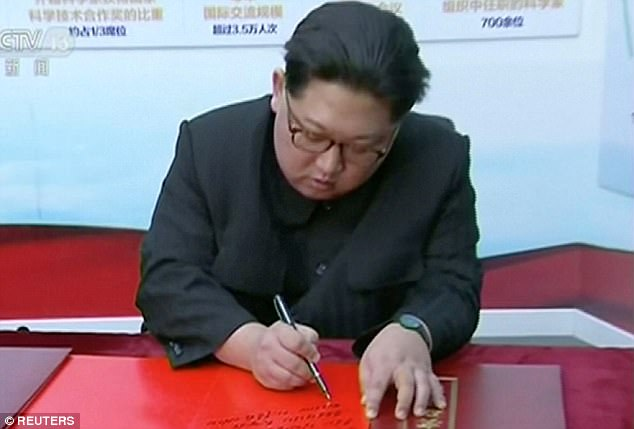 Kim signs a message during his trip to Beijing, which was only recently confirmed by China