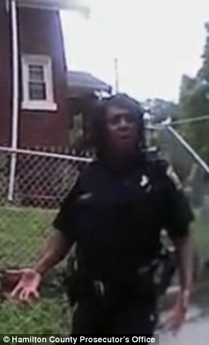When a female cop (pictured) arrives at the scene, Lindenschmidt tells her that Tensing 'went down when he got tangled in the car, and fired'