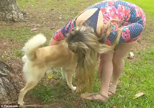 Horrifying: In the video, it shows her catch her dog's urine in a cup before drinking it