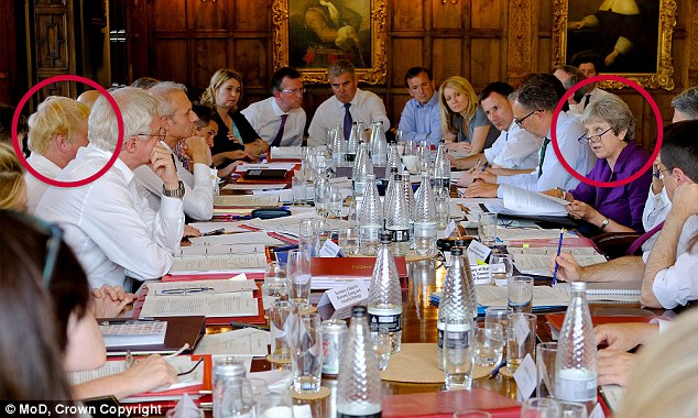Boris Johnson, pictured left, stunned fellow ministers with a four-letter dismissal of Theresa May's Brexit plan during Friday's Chequers meeting after Mrs May, right, called for loyalty