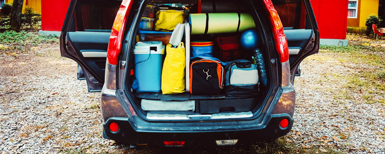 Van packed for camping. Inexpensive camping ideas for the family.