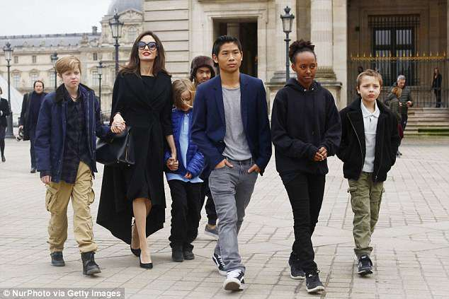 The family: Together they have six kids, Maddox, 16, Pax, 14, Zahara, 13, Shiloh, 12, and 9-year-old twins Vivienne and Knox; seen in 2017