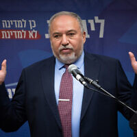 Head of the Israel Beyteinu party Avigdor Liberman speaks with the media during a faction meeting in the Knesset on November 25, 2019. (Hadas Parush/Flash90)