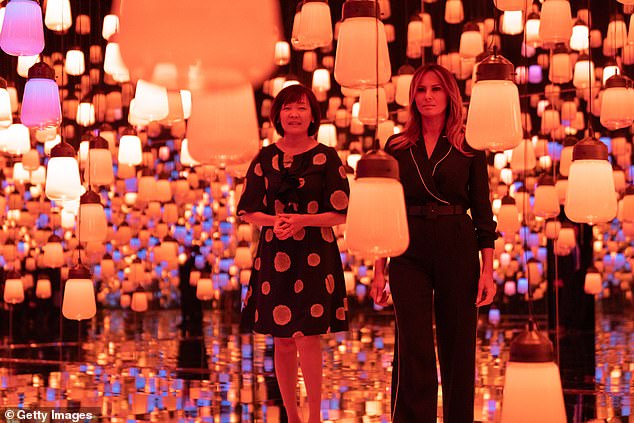 The first lander and her Japanese counterpart toured a digital art museum while their husbands golfed