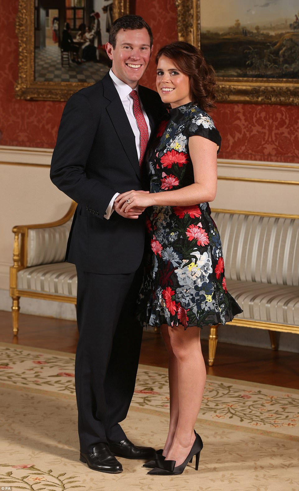 Princess Eugenie and Jack Brooksbank in the Picture Gallery at Buckingham Palace in London after they announced their engagement. The Princess opted for an Erdem dress and Jimmy Choo shoes