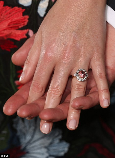 As befitting a modern bride, Eugenie's engagement brand ticks the trend for engagement rings with coloured stones