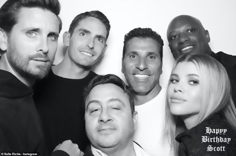 All together now: Sofia and Scott posed with his friends inside the lavish party