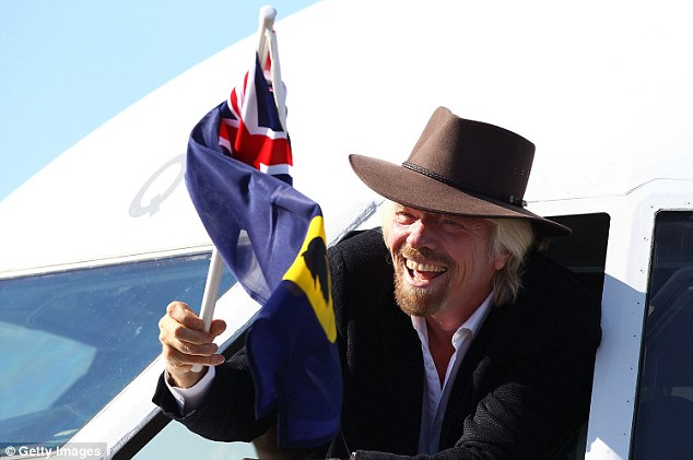 Sir Richard Branson waves a Western Australia flag from the cockpit on arrival at Perth Airport in 2013. Jack Welch points out that the best leaders know how to have fun and can celebrate with their teams