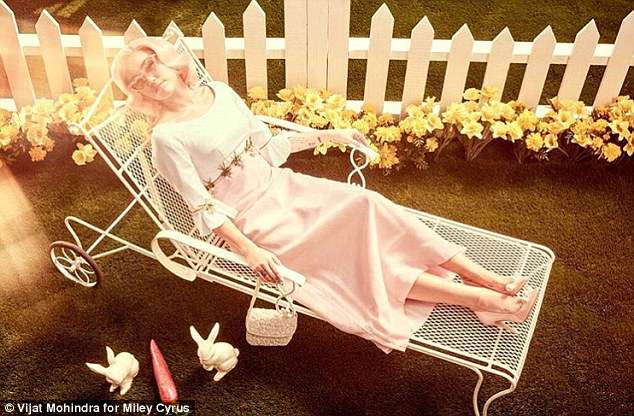 Time to chill: She wore a classy white and green dress while lounging on a chair