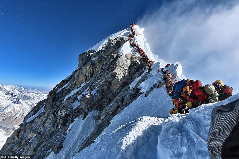 Massive line: In this picture taken on Sunday May 22, hundreds of mountain climbers line up to stand at the summit of Mount Everest Many teams waited for hours to reach the summit, risking frostbites and altitude sickness