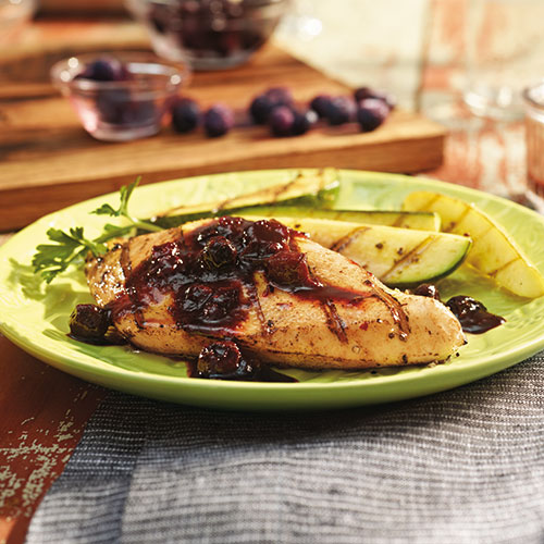 blueberry balsamic bbq sauce over chicken breast on plate